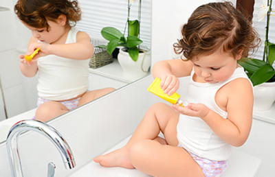Child applying eczema-friendly lotion