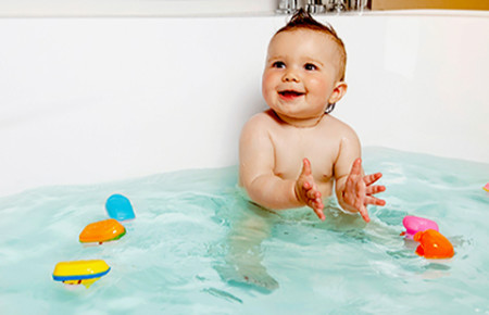 happy baby in bath