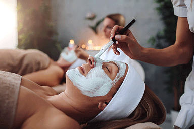 Woman enjoying a facial beauty treatment in a spa center