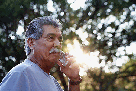 An older man talking on a cell phone