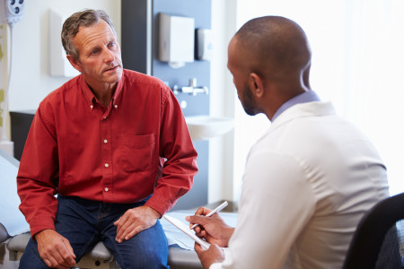 Male patient and doctor have consultation