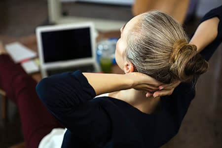 Woman with hair tightly pulled back