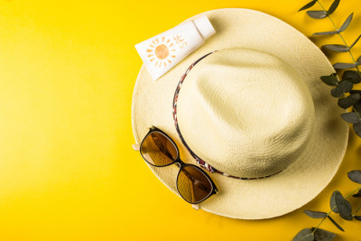 Image of summer hat, sunglasses and sunscreen