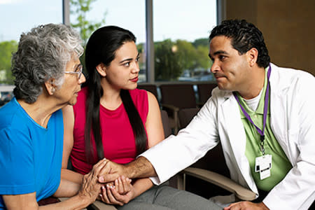 A dermatologist meets with his patient and her daughter