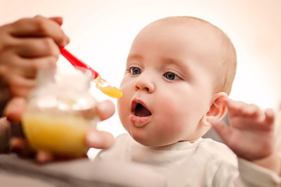 Baby eating. Parents often experiment with food in hopes of curing eczema, but research shows this seldom works.