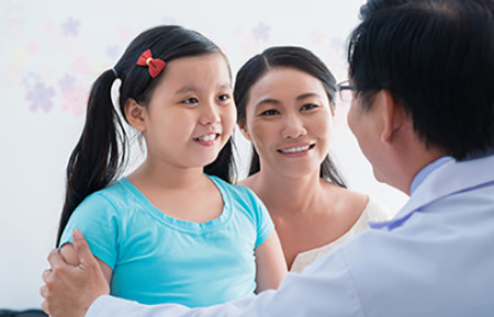 Girl with her dermatologist. Following a dermatologist's treatment plan can help a child feel better.