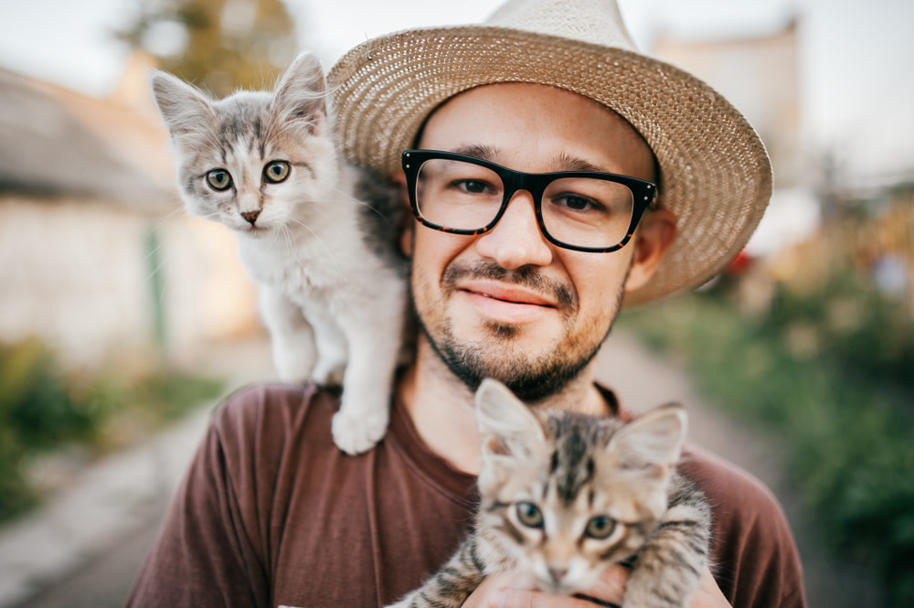 man with his two cats