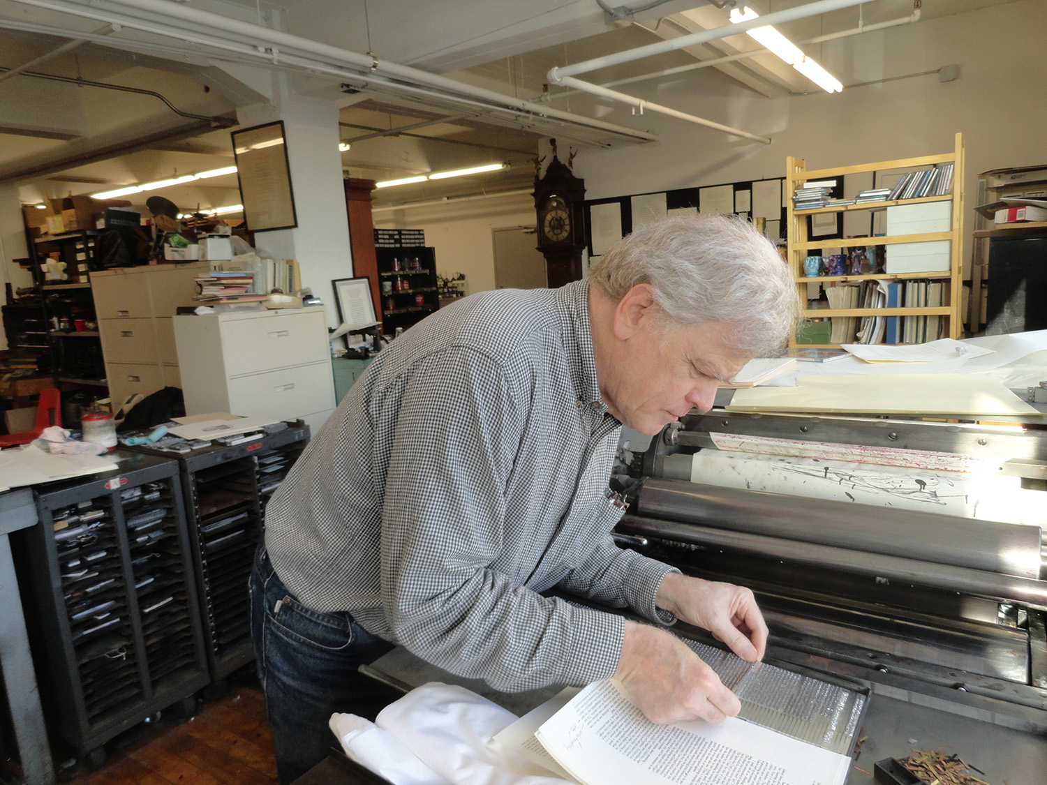 Bruce Kennett inserting a Linotype slug on press