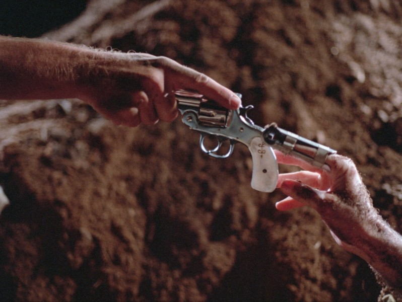 Blood  Simple - banner- gun