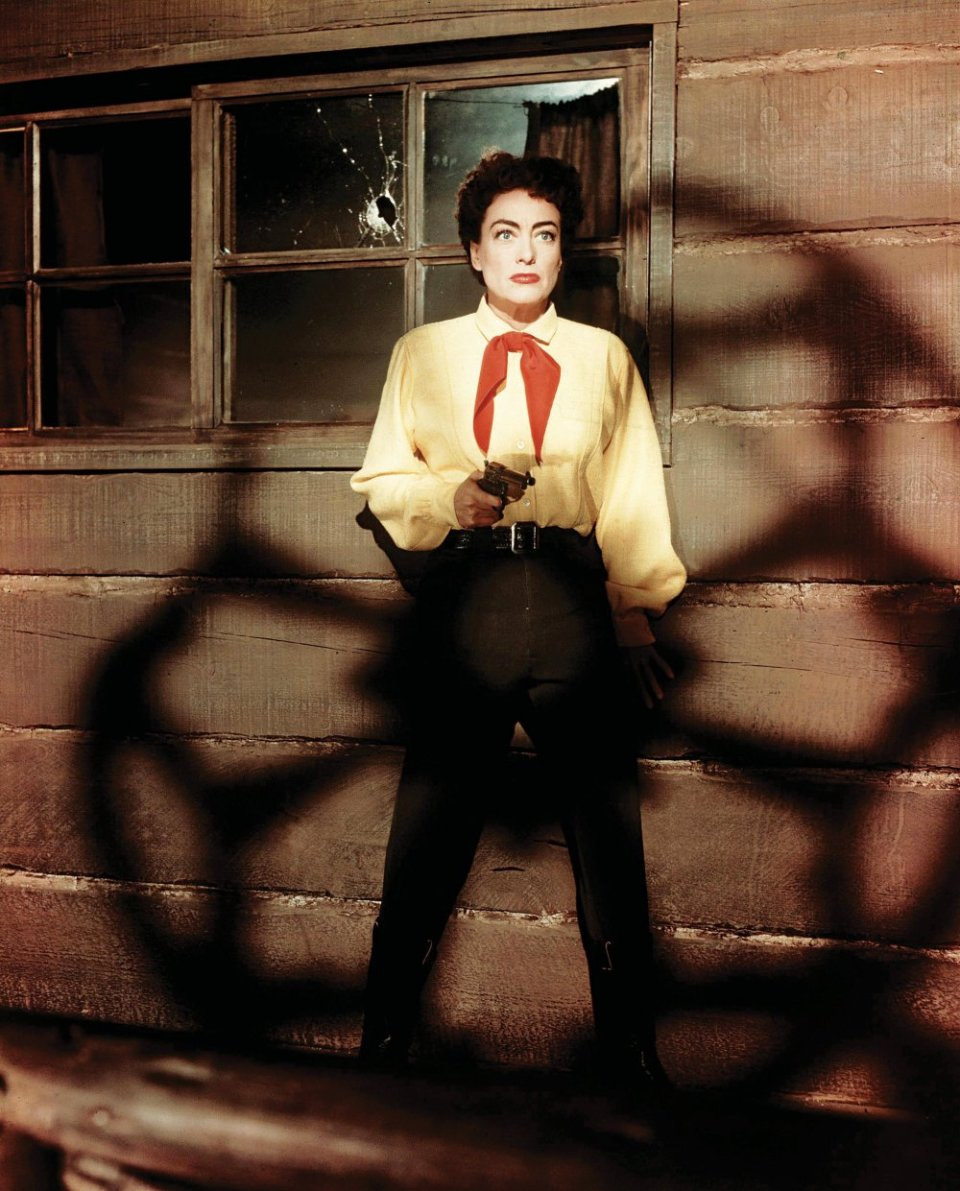 johnny-guitar-1954-003-joan-crawford-alert-with-gun-against-shaded-building-wall