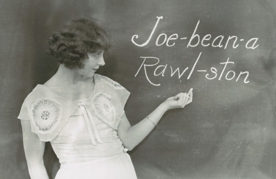jobyna-ralston-silent-film-actress-and-harold-lloyds-main-leading-lady-phoenetically-writing-her-name-on-a-blackboard