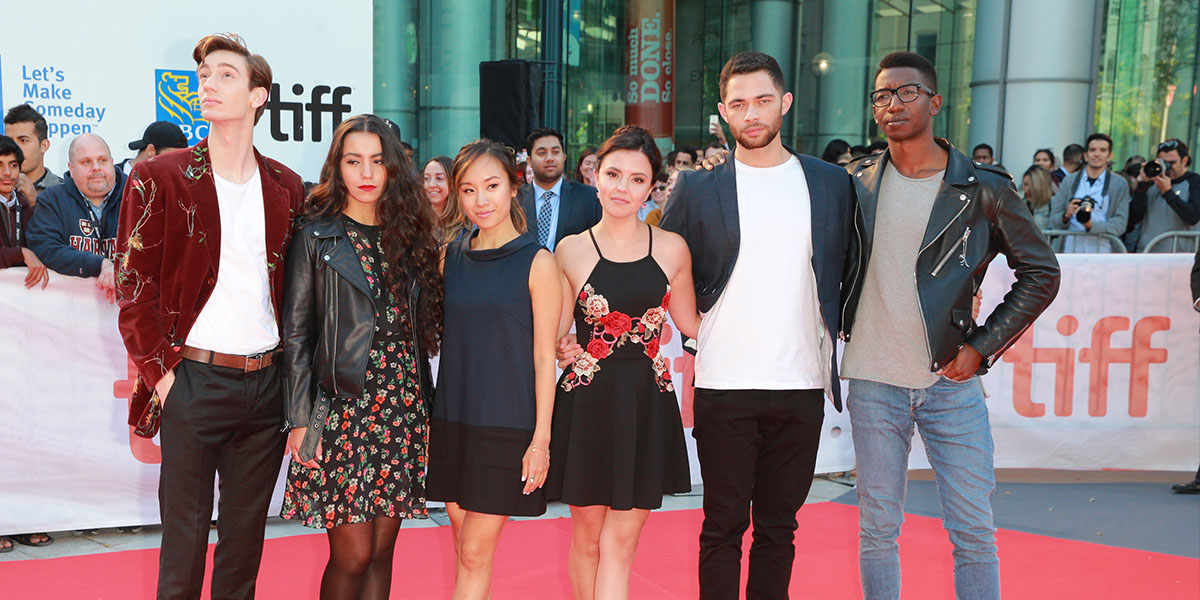 Group of Rising Stars posing on TIFF red carpet