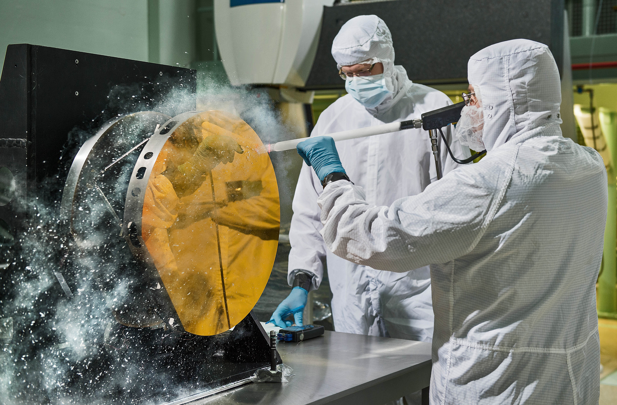 NASA engineers cleaning mirror with carbon dioxide snow