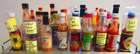 A tray of different bottles of hot sauce