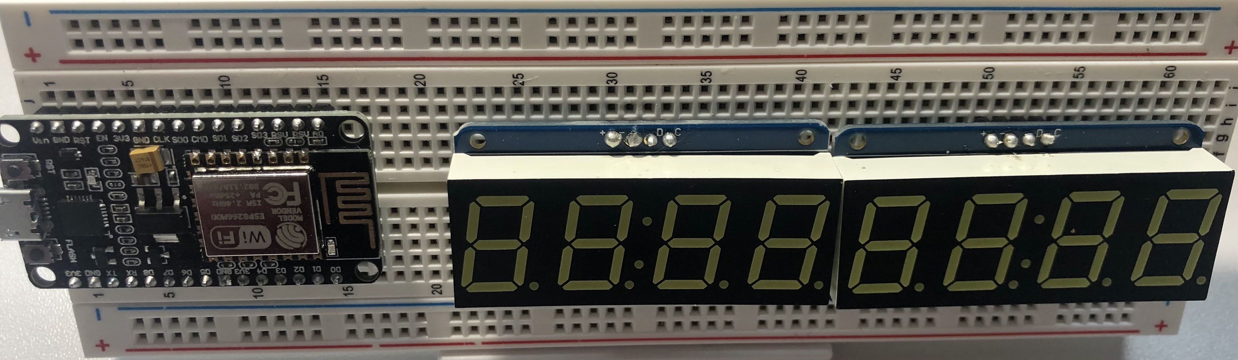 Place NodeMCU and two 7-segment displays in solderless breadboard