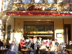Brel - outside view with relaxing people
