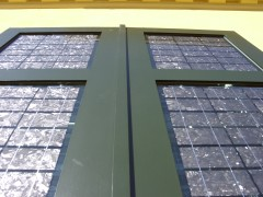 Solar Window Shutter with green wooden frame and silvery multicrystalline solar cells