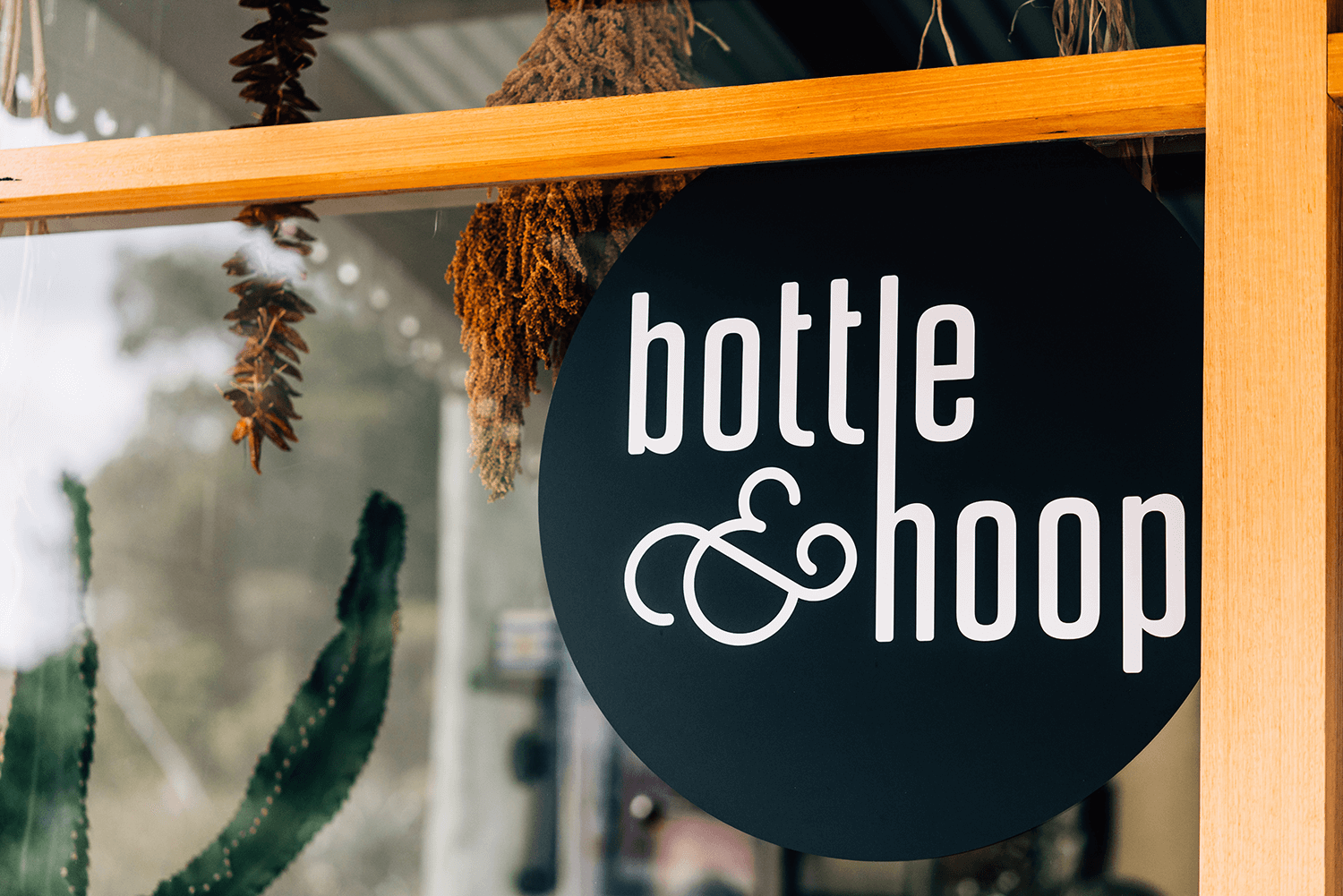 Bottle and Hoop sign