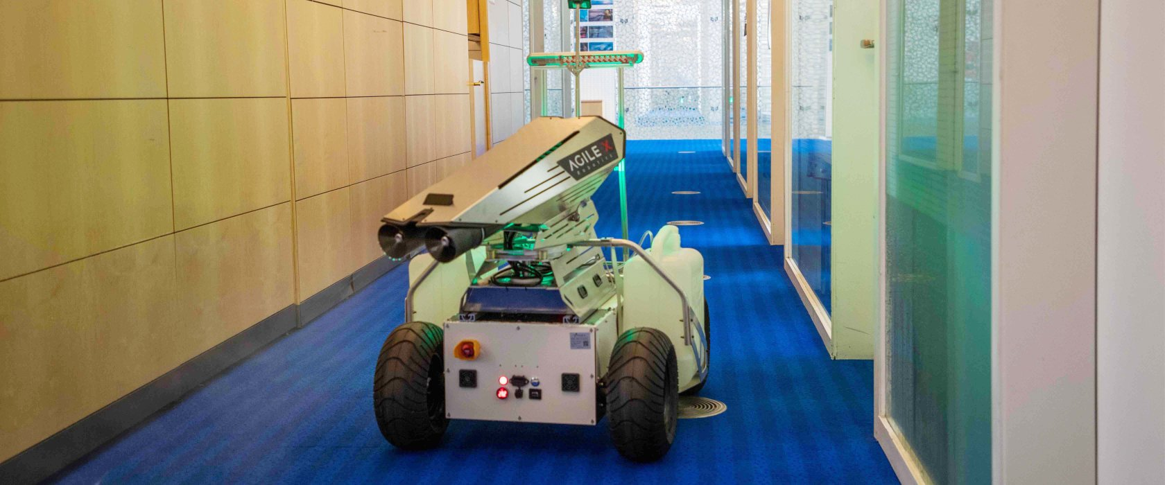 The QF student's robot that is a security guard by day, and a cleaner by night