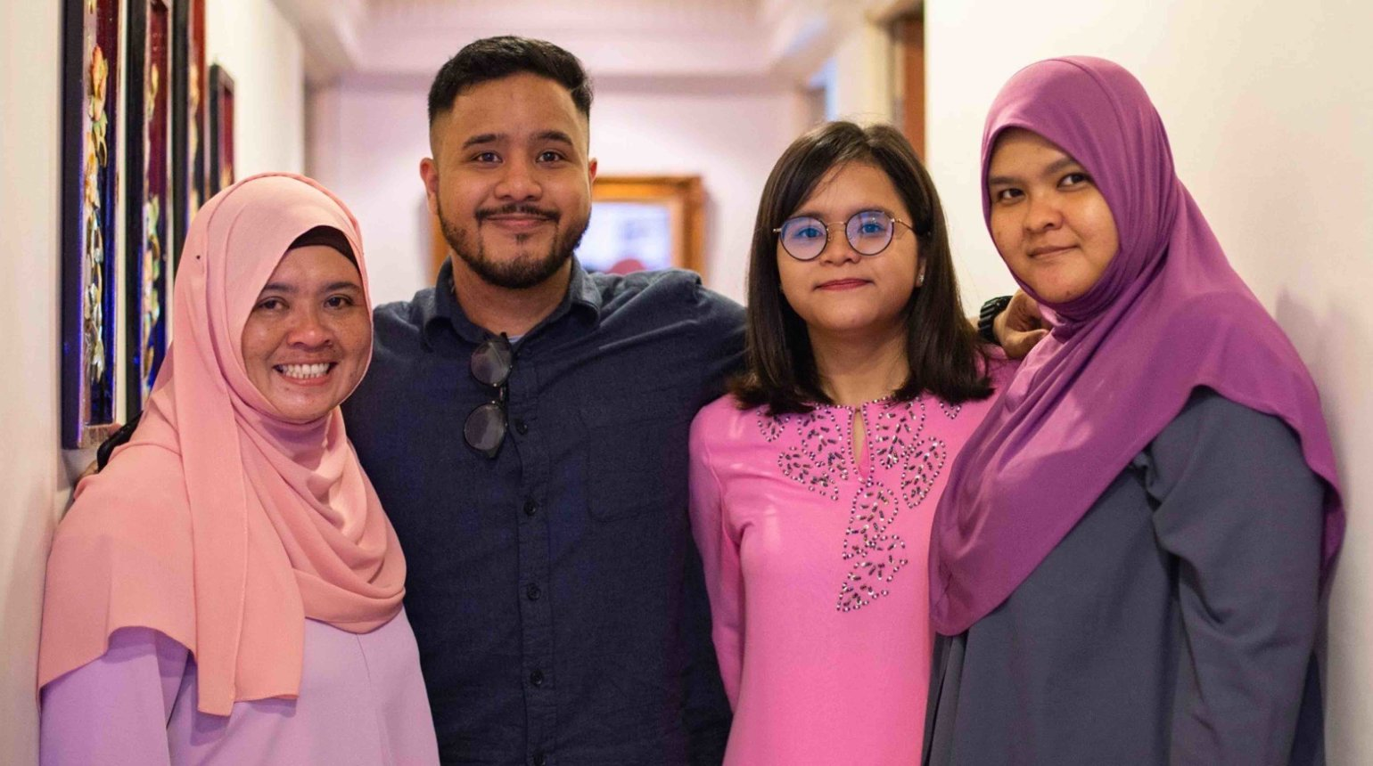 <p>Hussain grew up in Singapore with his single mother (left) and two sisters (right).</p>