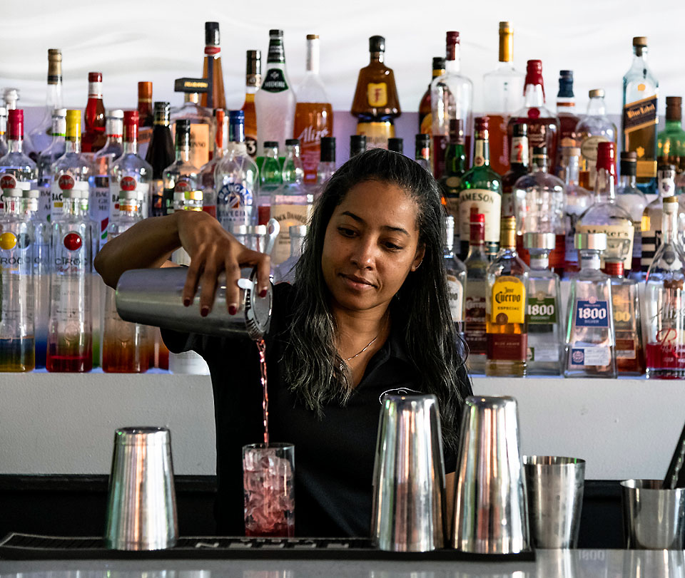 Bartender making drinks at the Mott Haven Bar and Grill