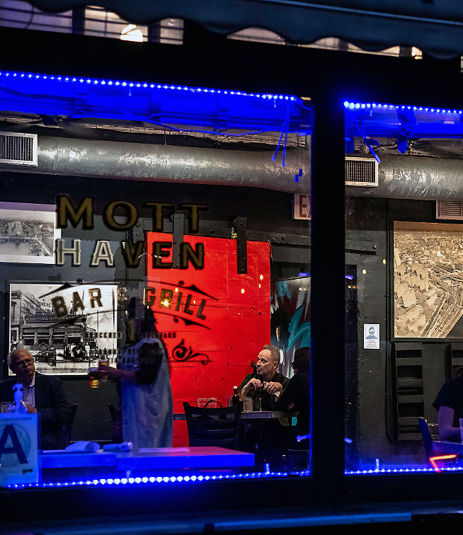 Looking into the window of the Mott Haven Bar and Grill