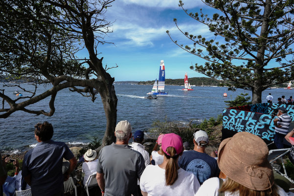 Spectators watch France SailGP Team helmed by Billy Besson in action from Shark Island on Race Day 2