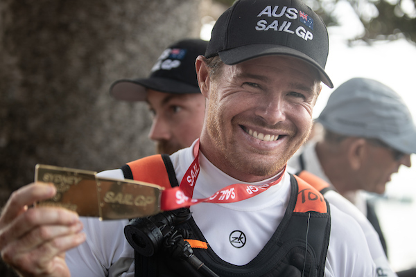 Helmsman Tom Slingsby celebrates winning Sydney SailGP