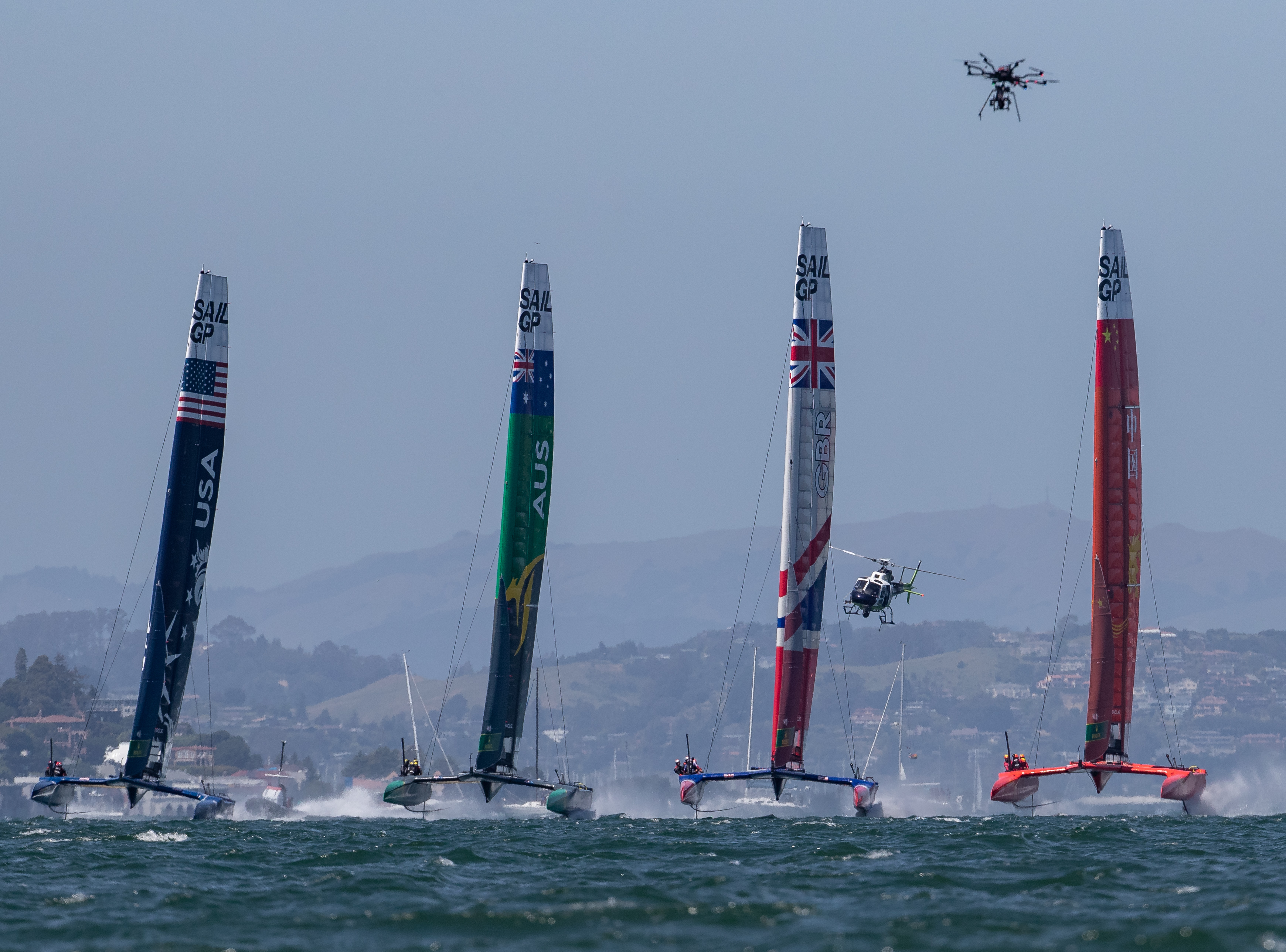 Big action and helicopter and drone add to the picture by Eloi Stichelbaut - San Francisco SailGP