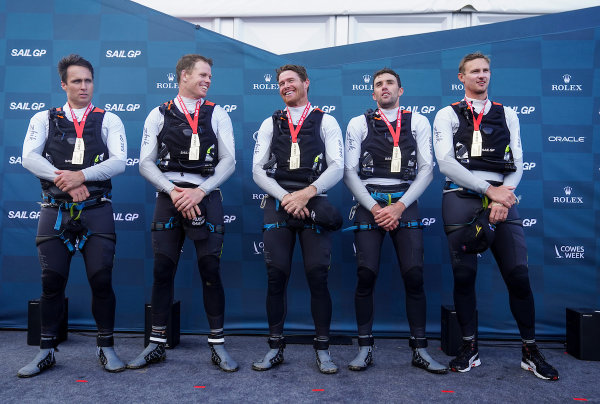 Australia SailGP Team, Ky Hurst, grinder, Sam Newton, grinder, Tom Slingsby, helmsman, Jason Waterhouse, flight controller and tactician, and Kyle Langford, wing trimmer, celebrate on the stage with their medals