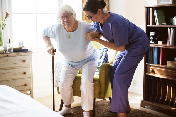 Home health care workers help patients with necessary tasks.