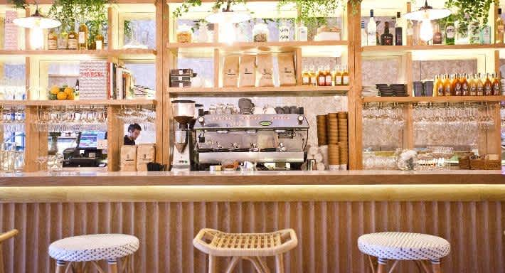 Interior photo of Merci Marcel in Singapore with bar seating and coffee machine at the counter