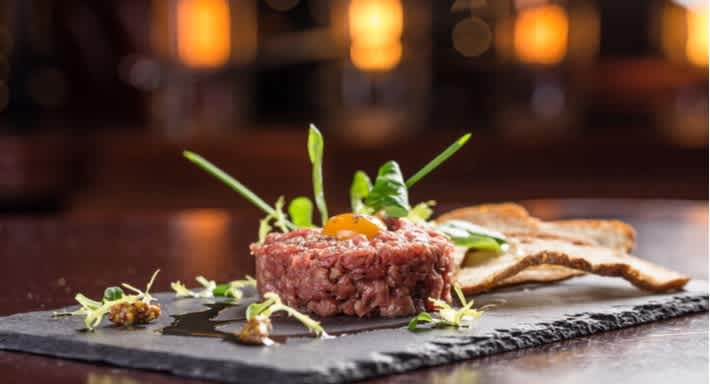 Steak tartare, a classic French dish, is one speciality at The Coach. Source: Shutterstock \[…\]