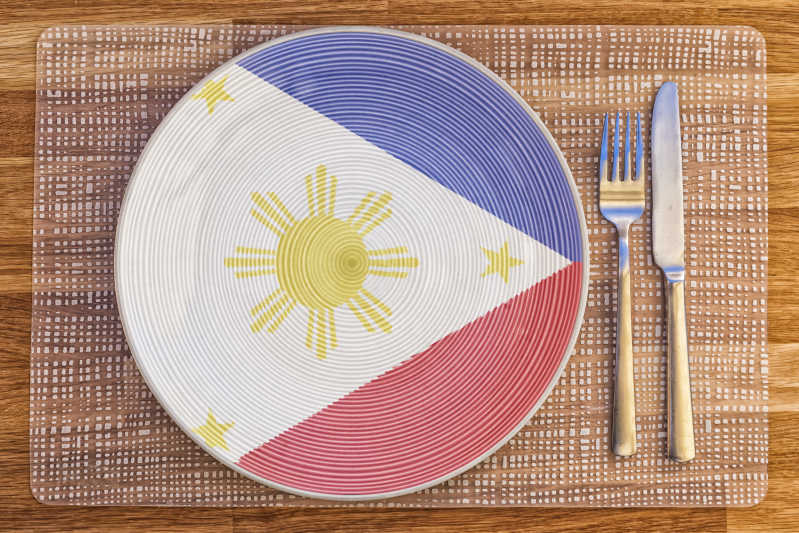 The Filipino flag on a plate with knife and fork