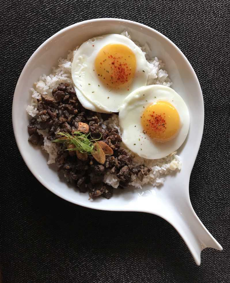 Fried egg served on top of Filipino pork adobo