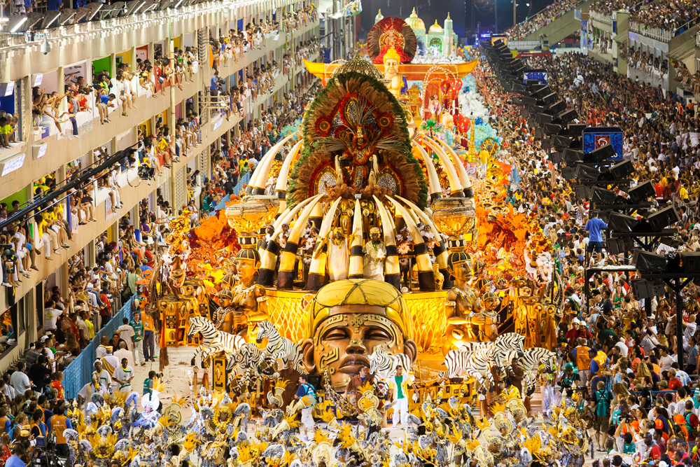 Samba schools in a parade during Carnaval in Brazil.