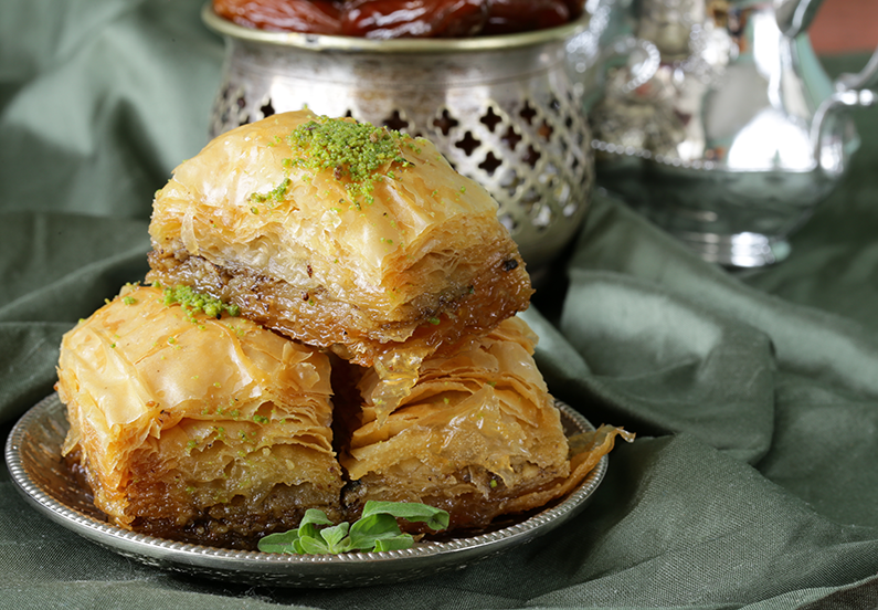 A plate of baklava, a sweet Levantine pastry filled with chopped nuts and soaked in honey.