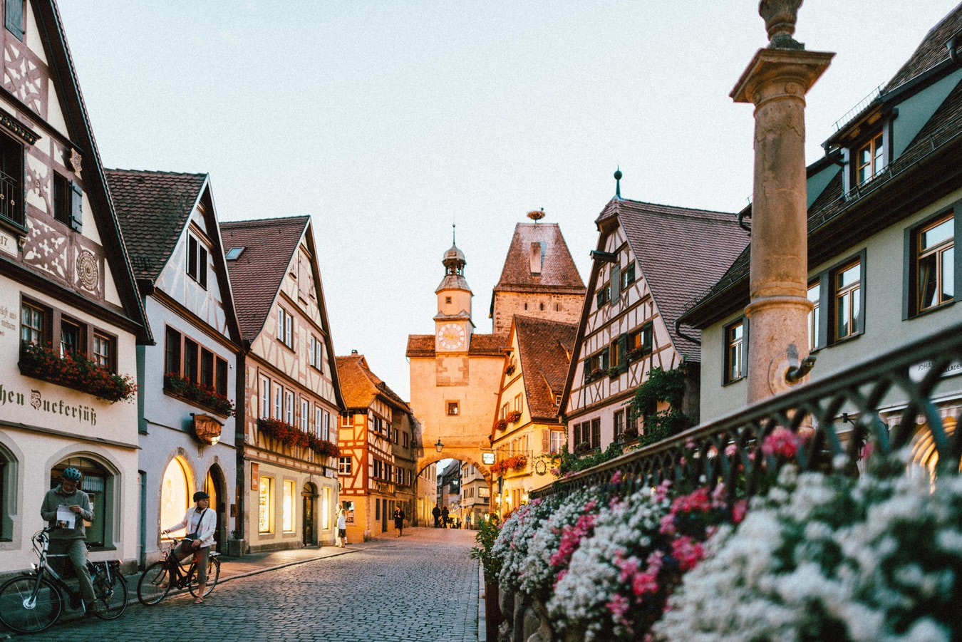 A couple on bicycles in Rothenburg, Germany.