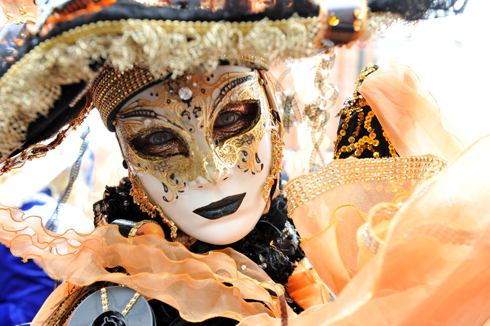 A woman wearing a Venetian mask for the Carnival of Venice.