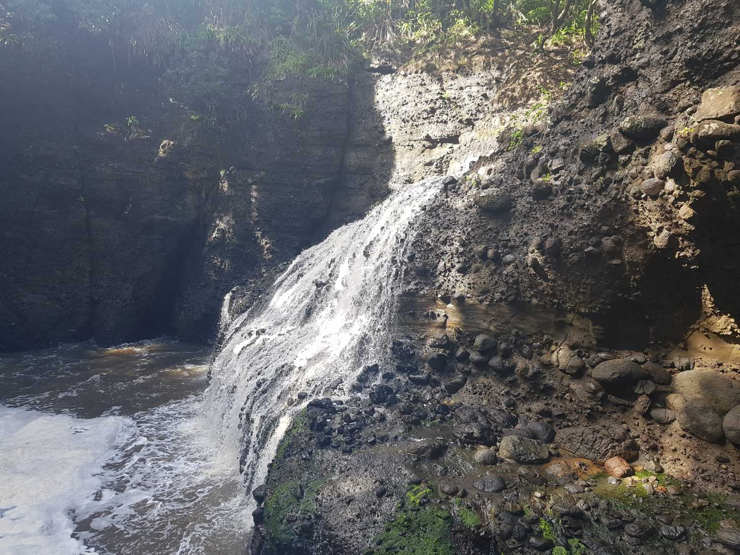The waterfall at Piha's blowhole after heavy rains