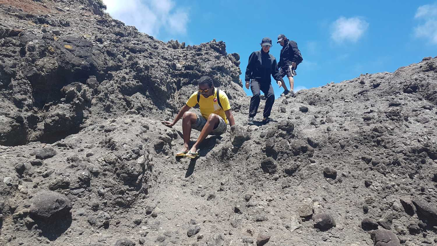 Group scales the rocks at Anawhata Beach