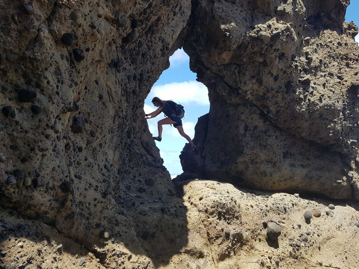 Finding a window in the rocks at Anawhata Beach