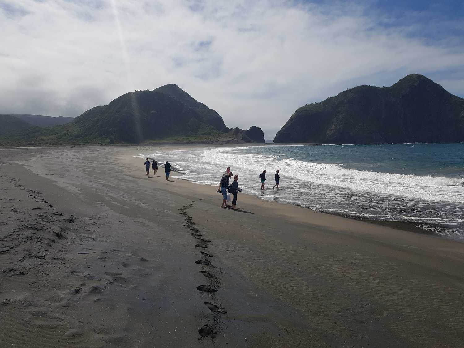 Hiking on Whatipu Black Sand Beach