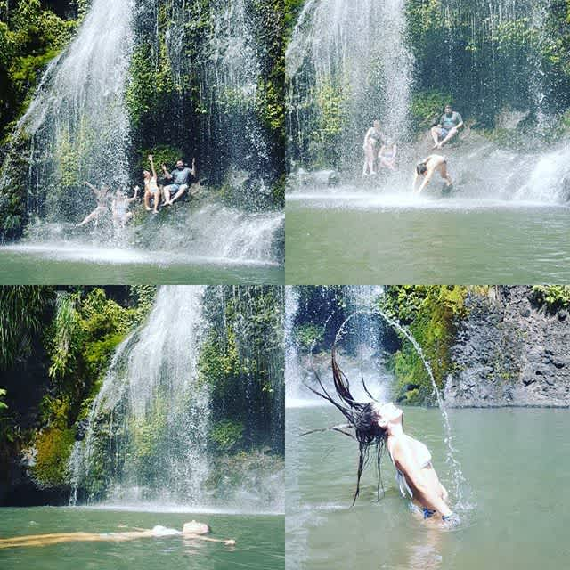 Tourists swimming at Kitekite falls