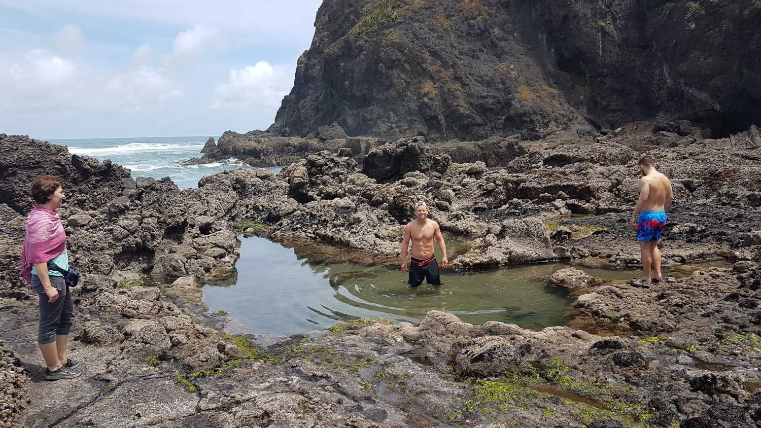 Group relaxes in rock pools at Anawhata