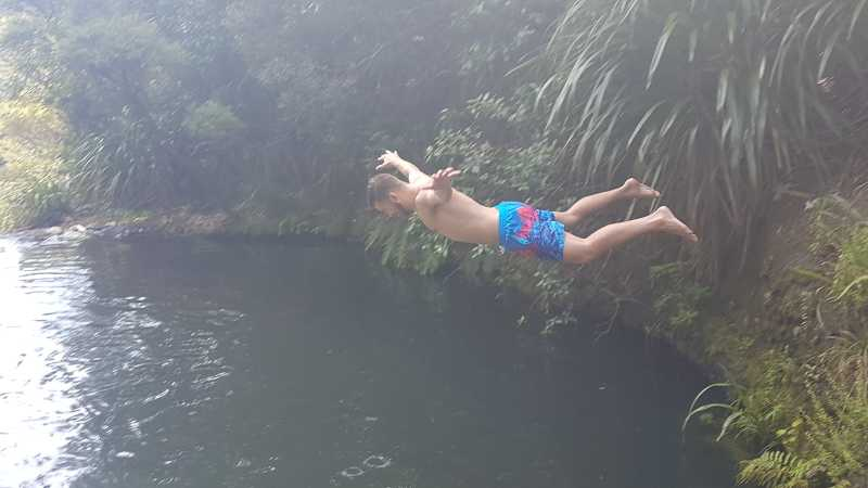 Diving the top pools of Kitekite Falls with Black Sand Tours