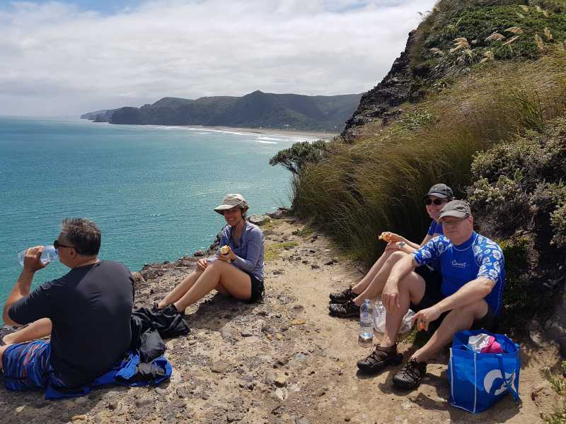Tour group enjoys the view at Piha beach