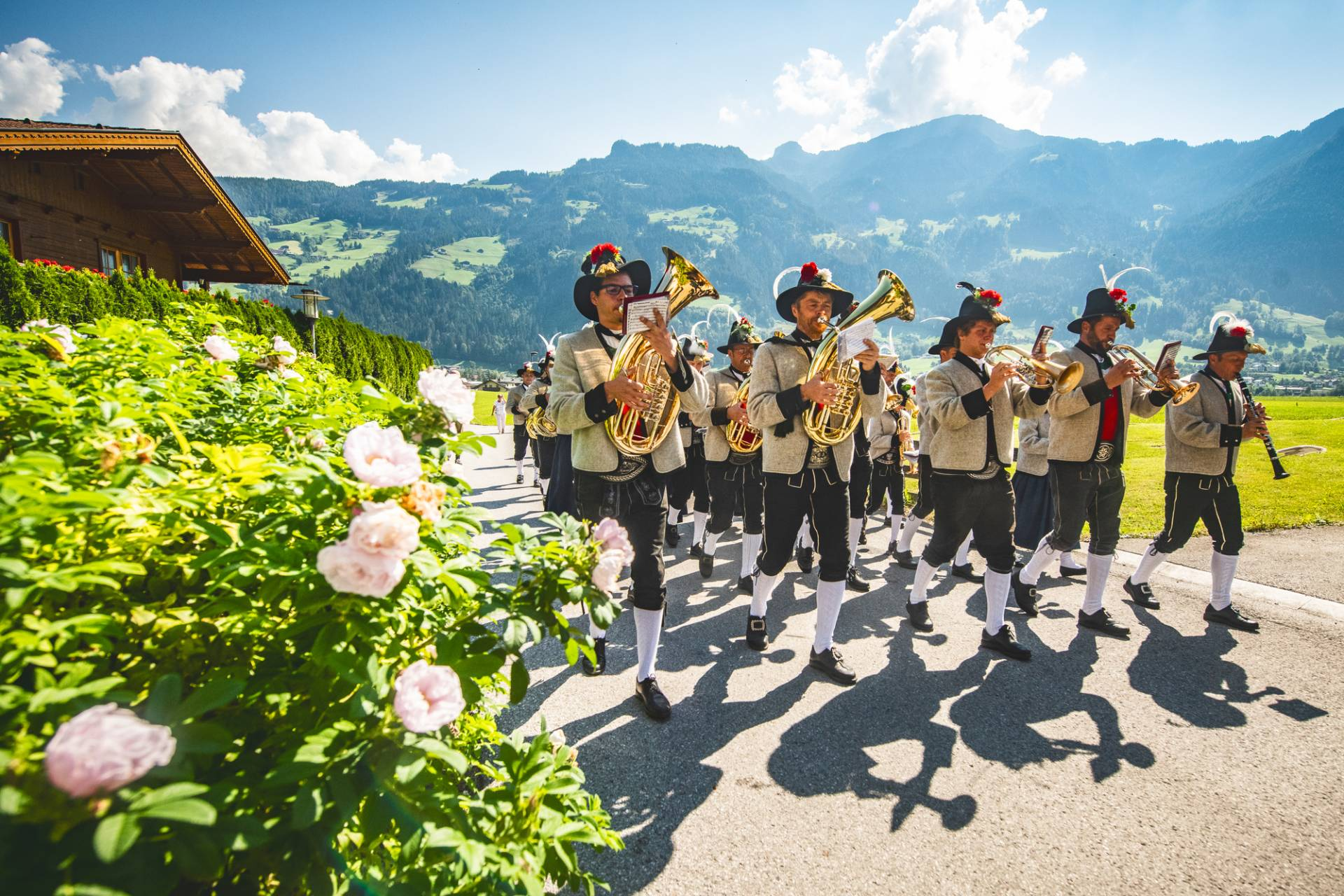 Traditional brass band group playing music and marching