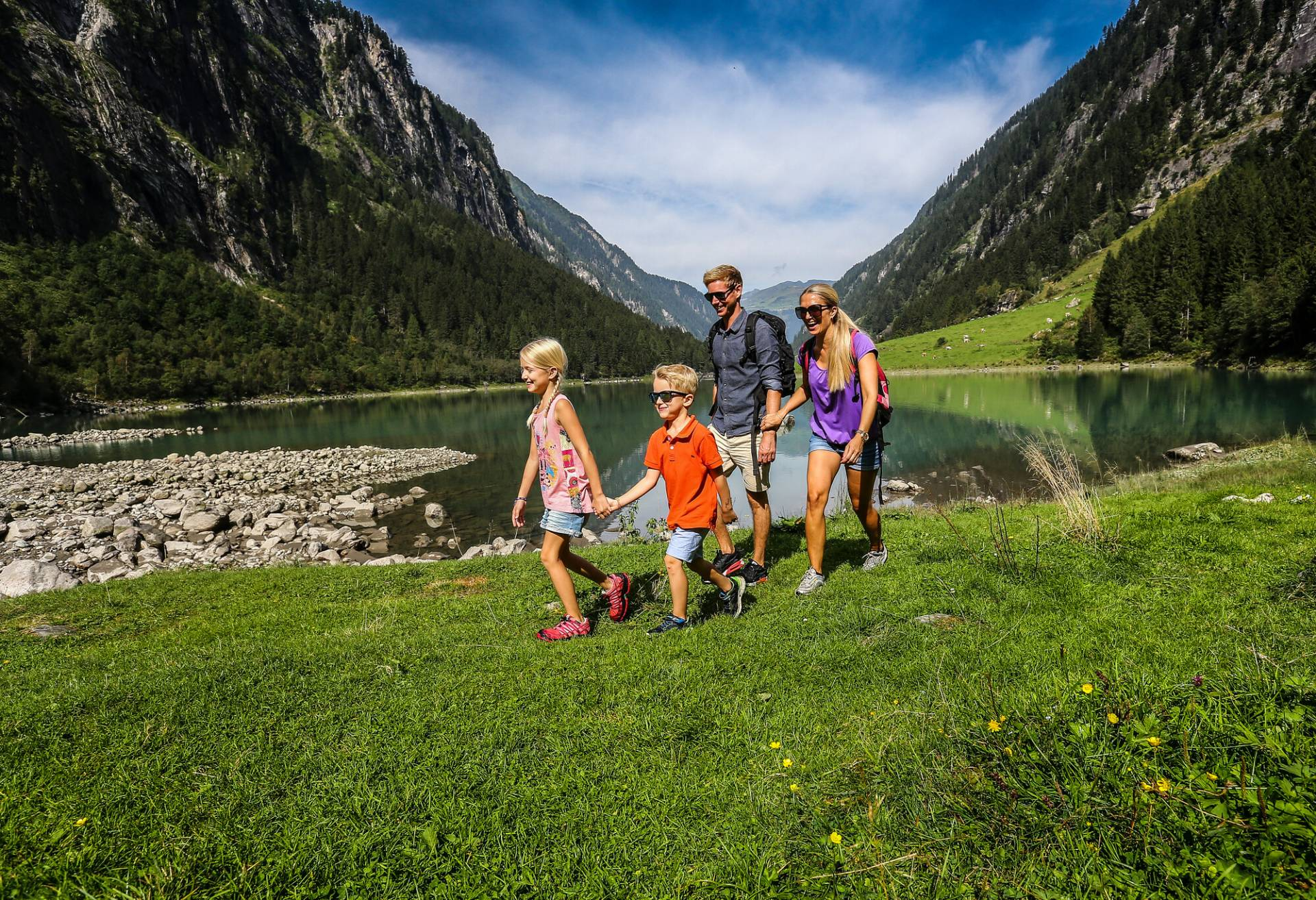 Family on the road in the mountains