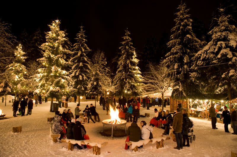 Deep winter forest festival area with fireplace as part of Mayrhofner Advent